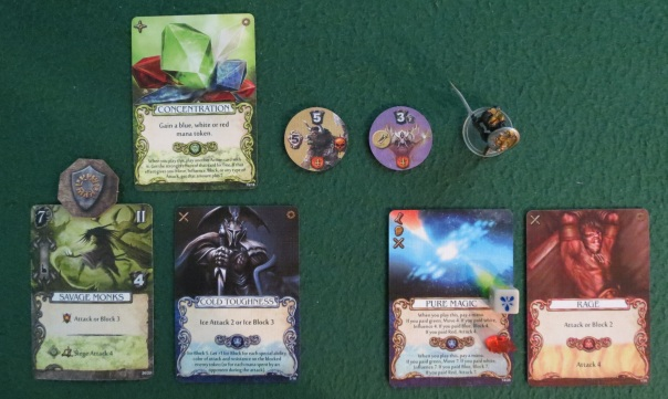"""Let's talk mana. Every day and night, some colorful dice are rolled. These indicate natural mana power that any Mage Knight can take advantage of. Normally you can only use one of these dice every turn, but some cards let you use more. You can also find or manufacture colored crystals that you can use. And some cards give you mana """"tokens,"""" which means temporary mana that must be used up before the end of the turn. In this instance, Tovak used """"Concentration"""" to have a red mana token. He empowered """"Pure Magic"""" with a blue die, then used that mana token to empower that ability to make a powerful attack."""