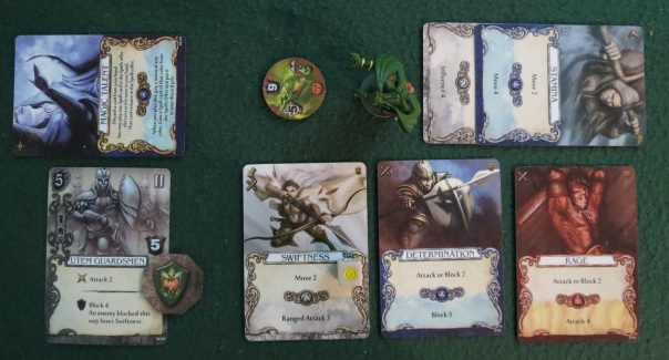 Combat is resolved in phases. The first is the Ranged Phase: If you can kill an enemy with ranged or siege cards, then they will never have the chance to attack you at all. This isn't always so easy. Not only are ranged cards rarer than normal attack cards, but if your enemy is fortified, ranged cards will not work. There are even ways to block siege cards, in which case you'll need some sort of special ability (or be willing to take a few hits) to win. And you can't inflict partial hits on an enemy now and finish them off later — combat is all-or-nothing, and you need to inflict enough hits to kill. The second phase gives you a chance to Block your enemy's attack, and again, you need to play enough block actions to block *all* damage, since you cannot block only part of an attack. In this case, exhausting the Utem Guardsmen plus a sideways card for +1 block was enough to match the Swamp Dragon's 5 attack.
