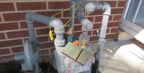 The contours of the gas meter reveal both the complacency and intrusion and — indeed — even the irony of modern convenience.
