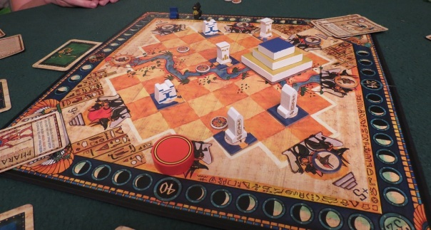 I'm not sure whether every game comes with these wooden pieces. I think most editions use cardboard standees. More's the pity, because with the wooden bits Heir to the Pharaoh looks *awesome*.